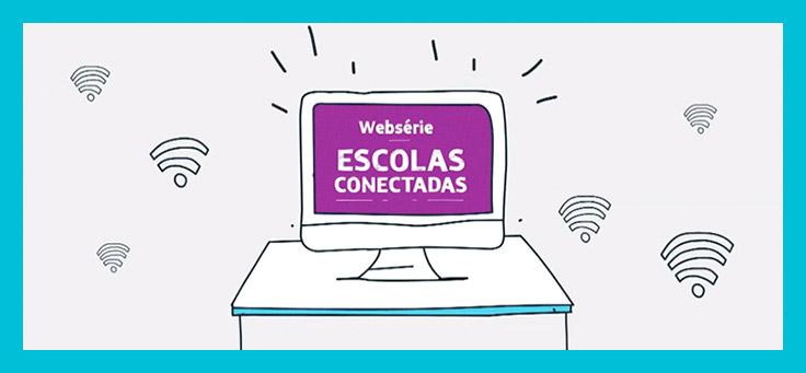Imagem mostra tela de computador com o logotipo da websérie Escolas Conectadas. O computador está em cima de uma mesa.